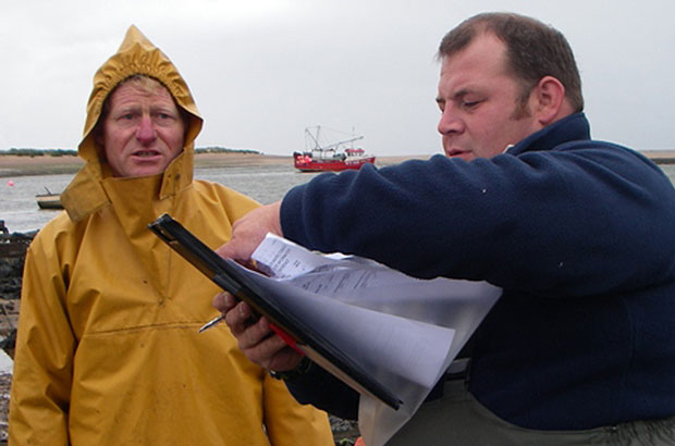 A Fish Health Inspectorate undertaking a compliance inspection on a shellfish farm.