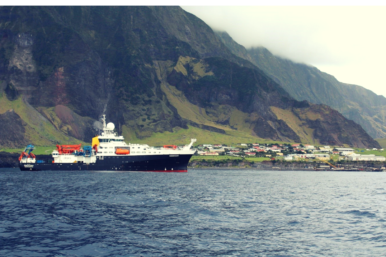 the RRS Discovery ship in front of the island Tristan da Cunha