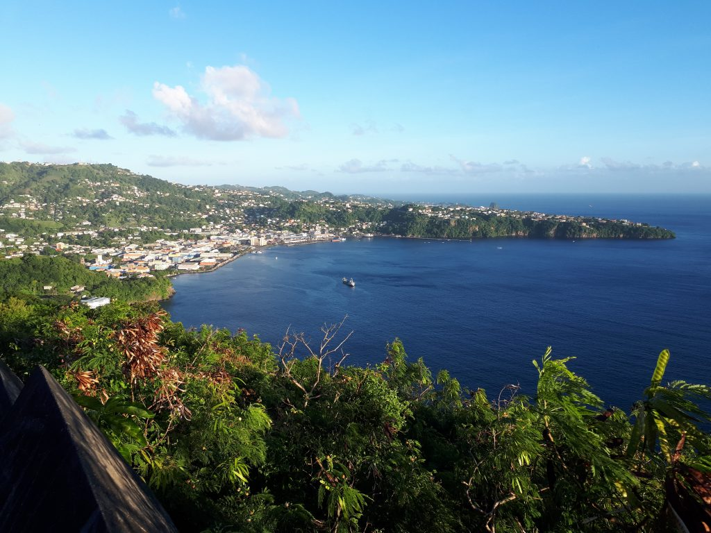 grass covered hills, settlements and the bay at Kingstown, St Vincent and the Caribbean Sea