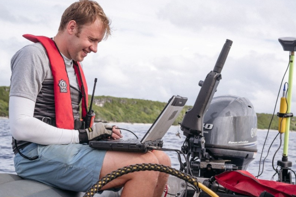a man on a boat on a computer